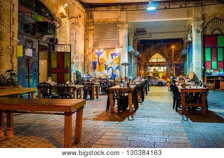 TEL AVIV ISRAEL - FEBBRUARY 25 2016: The cozy outdoor cafe in old Jaffa located in the small backstreet on February 25 in Tel Aviv.