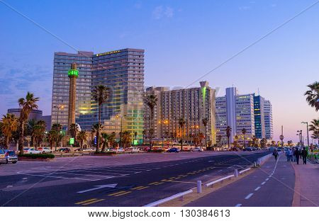 TEL AVIV ISRAEL - FEBBRUARY 25 2016: The coastal district with its luxury hotels looks great in the evening on February 25 in Tel Aviv.