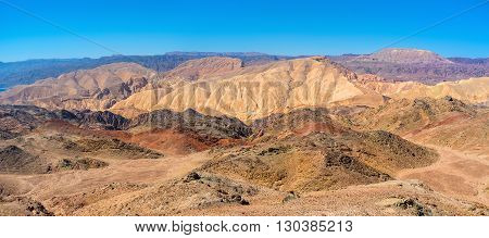 The red yellow brown and grey slopes of Eilat mountains Israel.
