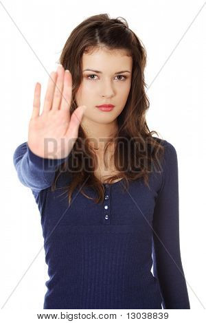 Hold on, Stop gesture showed by young teen woman hand. Isolated on white poster