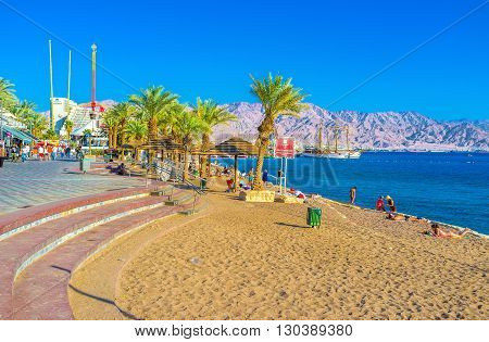 EILAT ISRAEL - FEBRUARY 23 2016: The North Beach of Eilat is one of the most popular beaches of the resort on February 23 in Eilat.