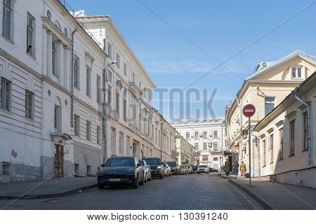 MOSCOW - MARCH 29: Uvarov House (left) on Bolshoi Spasoglinischevsky Street on March 29 2016 in Moscow. Uvarov House is Russian architectural monument.