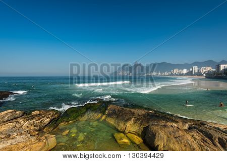 Rocks of Arpoador Beach and Ipanema Beach view in Rio de Janeiro, Brazil.