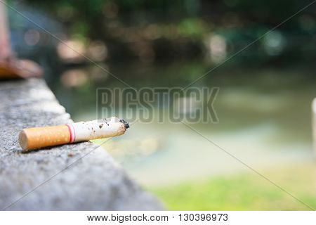 Disposable cigarette Placed on a cement floor