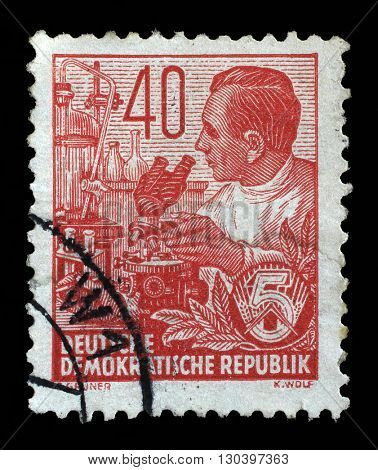 ZAGREB, CROATIA - SEPTEMBER 05: A stamp printed in GDR shows a Chemist, chemical plant, from the series Workers For The Five-year Plan, circa 1953, on September 05, 2014, Zagreb, Croatia