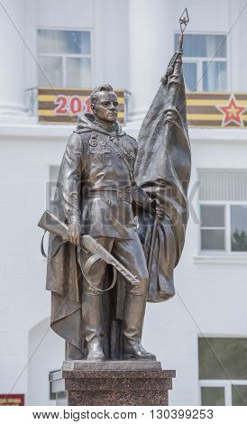 Rostov-on-Don Russia- May 142016: Monument party hoisting the Victory Banner over the Reichstag Alexey Berest. Sculptor Anatoly Sknarin