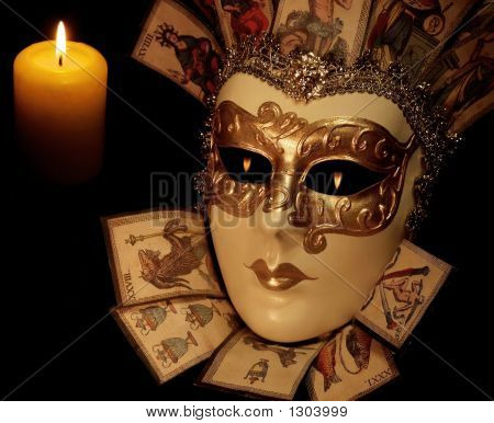 venetian carnival mask with candle and taro cards isolated on black poster