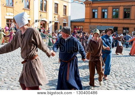 TURKU FINLAND 30 JUNE: The Medieval Market of Turku is historical reenactment event and includes a handicrafts market with participants garbed in period costumes on june 30 2013 in Turku Finland.