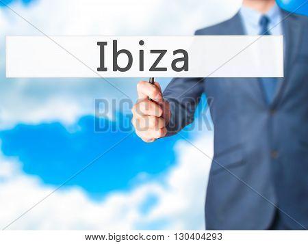 Ibiza - Businessman Hand Holding Sign