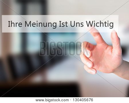 Ihre Meinung Ist Uns Wichtig! (your Opinion Is Important To Us In German) - Hand Pressing A Button O