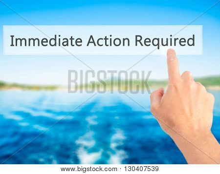 Immediate Action Required - Hand Pressing A Button On Blurred Background Concept On Visual Screen.