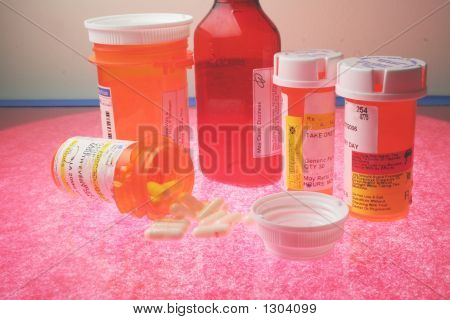 A Group Of Prescription Pill Bottles And Capsules