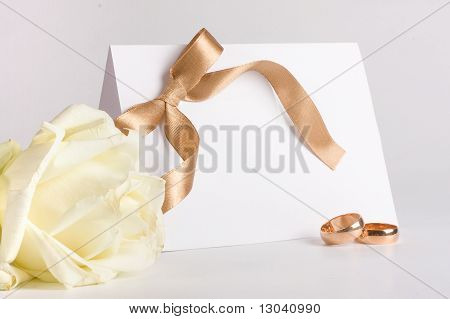 Wedding Rings And Invite With Rose