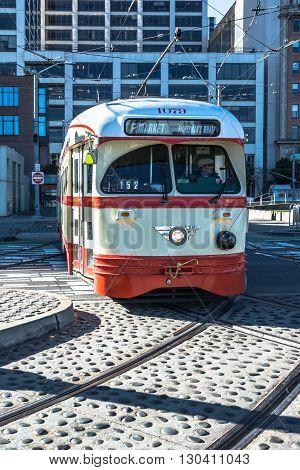 San Francisco,California,USA - January 1, 2015 : The beige red streetcar in Market Street