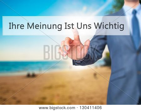 Ihre Meinung Ist Uns Wichtig! (your Opinion Is Important To Us In German) - Businessman Hand Pressin