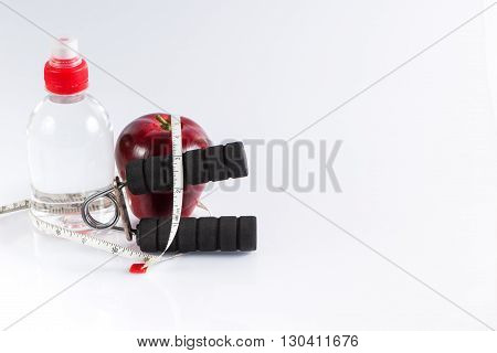 Fitness background with bottle of water dumbbell handgrip and heart