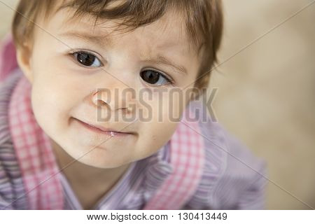 Close-up Of Adorable Little Baby Looking Away