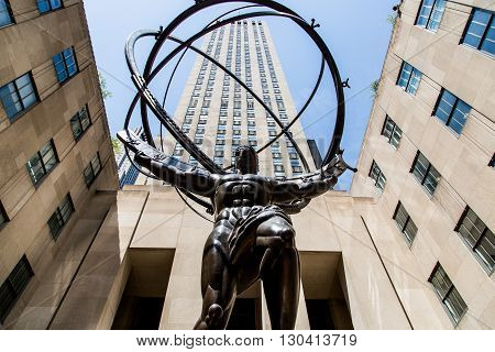 NEW YORK, USA - APRIL 21, 2016: Sculpture of Atlas in NYC. The sculpture depicts the Ancient Greek Titan Atlas holding the heavens. Created by Lee Lawrie and Rene Paul Chambellan it was installed in 1937.
