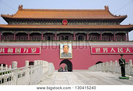 April 24 2016. Forbidden City Beijing China. A uniformed guard in front of the gate of great harmony (Tianan men) with a picture of Chairman Mao at the Forbidden City in Beijing China.