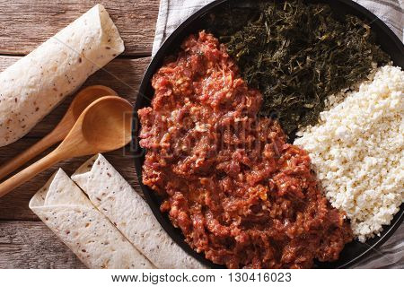 Ethiopian Cuisine: Kitfo With Herbs And Cheese. Horizontal Top View