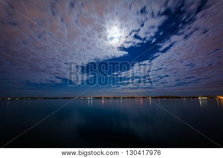 The Moon And Clouds Moving Over Lake Ontario, At The Harbourfront In Toronto, Ontario.