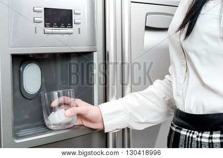 Refrigerator is making fresh clean ice cubes.