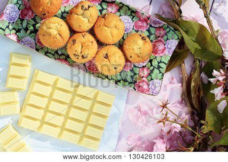 Fresh Scottish scones and white chocolate with cherry blossom background
