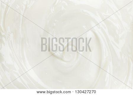 Texture of white tasty creamy mass. Yogurt sour cream cheese background.