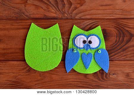 Soft felt toy pattern. Children sewing tutorial. Needlecraft sewing felt pattern. Felt body of a fabric owl. Stitched details toy