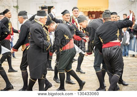 Perast Montenegro - May 15 2016: Shooting the Kokot (rooster) celebration. Celebrates the liberation of Perast from Turkish in 1654. Theatrical performance on a city street. Dance with hankerchief.