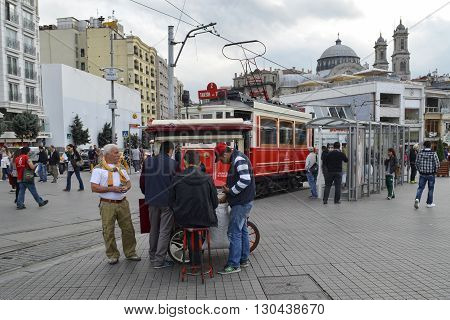 Istanbul Turkey - September 21 2012: the former tram on Istiklal Street in Istanbul Taksim-Tunel carry passengers. Greek Church in Taksim at the top looks.