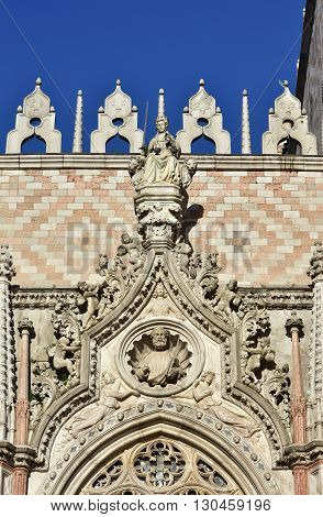 Beautiful gothic portal in Sain Mark Square with Goddess of Justice at the top