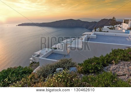 Amazing sunset view from town of Imerovigli to yown of Oia, Santorini island, Thira, Cyclades, Greece