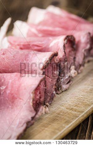 Sliced Roastbeef On Wooden Background