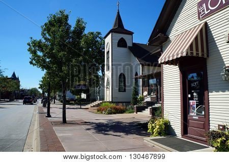 PLAINFIELD, ILLINOIS / UNITED STATES - SEPTEMBER 20, 2015: A sign in front of the former St Mary's Catholic Church welcomes visitors to downtown Plainfield.