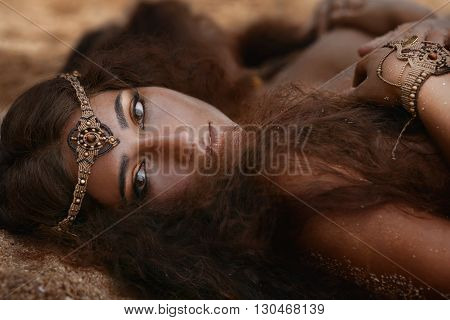Attractive young tribal woman in ethnic jewelry