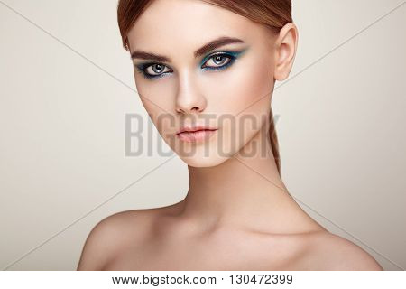 Beautiful woman face. Perfect makeup. Beauty fashion. Eyelashes. Lips. Cosmetic Eyeshadow. Perfect skin poster