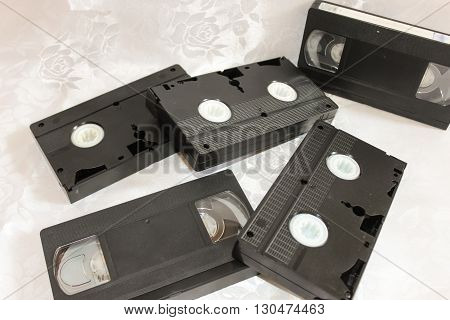Several old videotapes on a white background