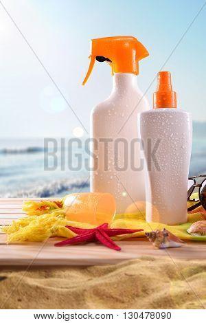 Suncream On Wooden Slats On The Beach Vertical Composition