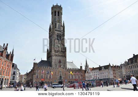 Bruges Belgium - May 11 2015: Tourist on Grote Markt square in Bruges Belgium on May 11 2015. The historic city centre is a prominent World Heritage Site of UNESCO.