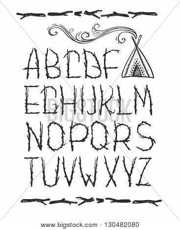 Alphabet made of branches of tree isolated on white background. Natural tribal font with tipi.