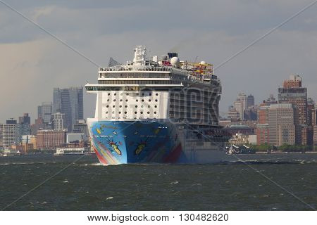 NEW YORK - MAY 15, 2016: Norwegian Breakaway Cruise Ship leaving New York harbor. Norwegian Cruise Line Ship is the world's eighth largest cruise ship start voyages on May 12, 2013