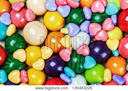 multicolored candy and chewing gum background bubble