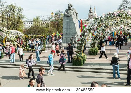 Moscow Russia - May 2 2016: Tourists and citizens walking on Revolution Square in Moscow. Festival