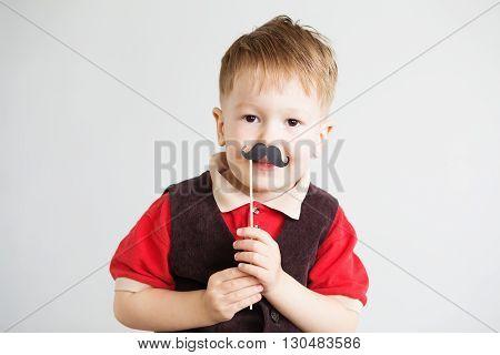 Portrait Of A Cute Little Boy With Funny Paper Mustache