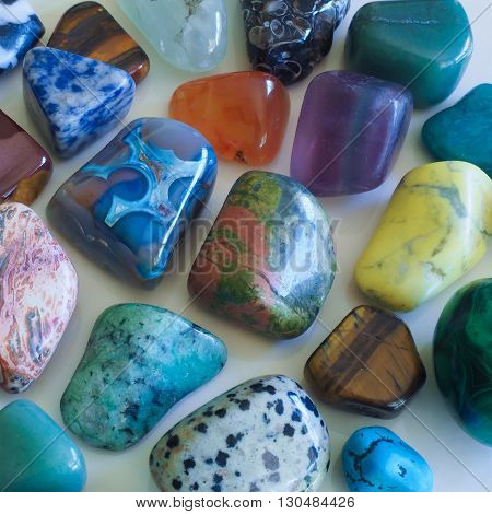 An assortment of semi-precious stones against a plain background.