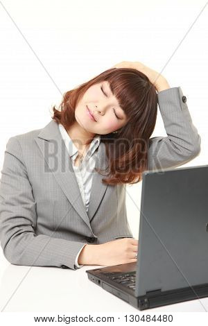 portrait of Japanese businesswoman suffers from neck ache on white background