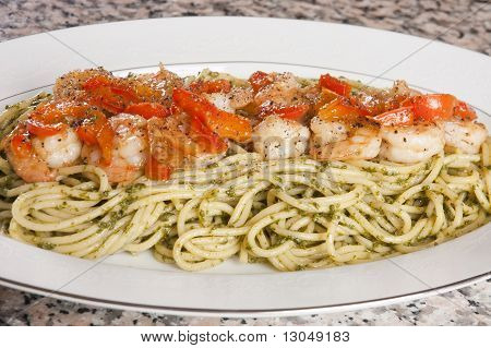 Grilled shrimp on a bed of pasta poster