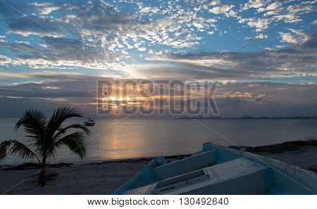 Sunrise over Puerto Juarez Bay and Beach in Cancun Mexico MEX