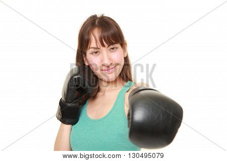 female boxer throws a left jab on white background